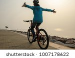 cyclist riding bike with arms... | Shutterstock . vector #1007178622