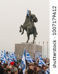 Small photo of Thessaloniki / Greece - 01/21/2018 : unknown Greek people are waving their Greek Flags next to the statue of Alexander the Great at the rally for the name Macedonia in Thessaloniki Greece