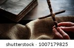 religious old book on a wooden...   Shutterstock . vector #1007179825