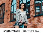 young beautiful girl rides her... | Shutterstock . vector #1007191462