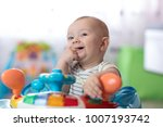 baby boy sucking his fingers at ... | Shutterstock . vector #1007193742