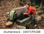 backpacker looking at camera... | Shutterstock . vector #1007195188