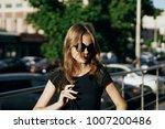 woman in sunglasses walking    ... | Shutterstock . vector #1007200486