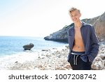 young man relaxing walking on... | Shutterstock . vector #1007208742