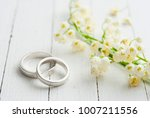 lily flowers  wedding rings  | Shutterstock . vector #1007211556