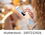beautiful female hands holding...   Shutterstock . vector #1007212426