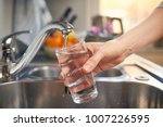 Pouring Fresh Tap Water Into A...