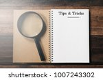 magnifying glass and notebook... | Shutterstock . vector #1007243302