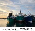 fishing trawlers stationed at... | Shutterstock . vector #1007264116