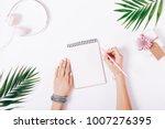 female hands write in a... | Shutterstock . vector #1007276395