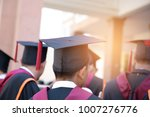 graduates wear graduation gowns ... | Shutterstock . vector #1007276776