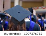 graduates wear graduation gowns ... | Shutterstock . vector #1007276782