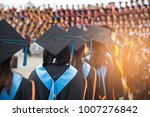 graduates wear graduation gowns ... | Shutterstock . vector #1007276842