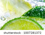 lemon slice drop in fizzy... | Shutterstock . vector #1007281372