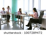 businesspeople working as a... | Shutterstock . vector #1007289472