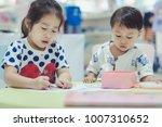 asian little cute boy and girl... | Shutterstock . vector #1007310652