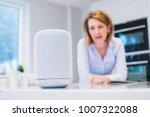 woman in kitchen asking digital ... | Shutterstock . vector #1007322088