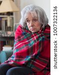 Small photo of Senior Woman Wrapped In Blanket Unable To Afford Heating Bills