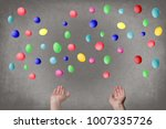 female hands juggle colorful... | Shutterstock . vector #1007335726