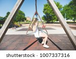 young beautiful woman in a city ... | Shutterstock . vector #1007337316