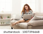 young redhead woman working on... | Shutterstock . vector #1007396668
