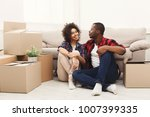 happy african american couple... | Shutterstock . vector #1007399335