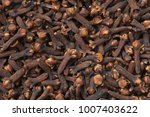 cloves background. dried spice... | Shutterstock . vector #1007403622