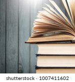 stack books open in the library | Shutterstock . vector #1007411602