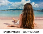 rear view of a young woman with ... | Shutterstock . vector #1007420005