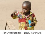 adorable african baby playing... | Shutterstock . vector #1007424406