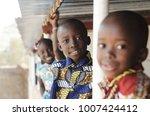 three african children smiling... | Shutterstock . vector #1007424412