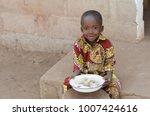 candid shot of little black... | Shutterstock . vector #1007424616