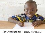 adorable african boy at school... | Shutterstock . vector #1007424682