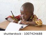 handsome young african boy... | Shutterstock . vector #1007424688