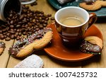 espresso and carnival sweets | Shutterstock . vector #1007425732
