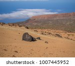 Small photo of desert volcanic landscape with purple mountains in el teide national nature park with Huevos del Teide (Eggs of Teide) accretionary lava balls on clear blue sky background