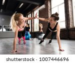 two friend at the gym doing... | Shutterstock . vector #1007446696