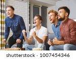 men watching sport on tv... | Shutterstock . vector #1007454346