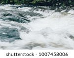 a powerful stream of mountain... | Shutterstock . vector #1007458006