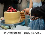 bride and groom cutting wedding ...   Shutterstock . vector #1007487262