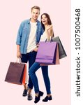 happy couple with shopping bags ... | Shutterstock . vector #1007500468