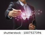 business man draws a brain.... | Shutterstock . vector #1007527396