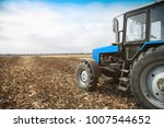 old blue tractor in a empty... | Shutterstock . vector #1007544652