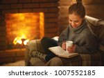young woman enjoys reading a... | Shutterstock . vector #1007552185