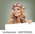 happy model with blank board... | Shutterstock . vector #1007559382