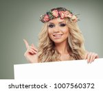 smiling woman holding signboard.... | Shutterstock . vector #1007560372