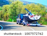 car with a motor boat at the... | Shutterstock . vector #1007572762