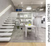 Small photo of Loft apartment with white mezzanine staircase, table, chairs and open kitchen