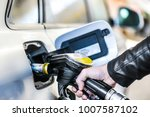 refueling car at gas station.... | Shutterstock . vector #1007587102
