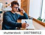 attractive thinking man taking... | Shutterstock . vector #1007588512